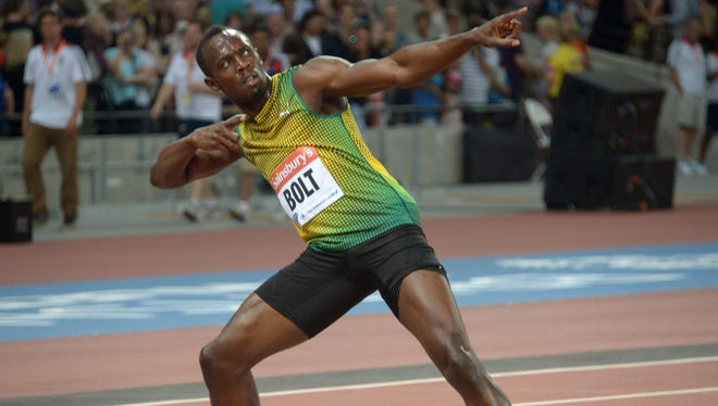 Usain Bolt poses after winning the 100-meter dash in 9.85 in the Sainsbury's Anniversary Games at Olympic Stadium.