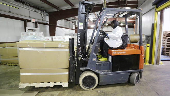 Fairplay Plymouth's Dexter Davis moves a skid load of packaged cheese, Thursday January 18, 2018 in Plymouth, Wis. Fairplay Plymouth is a division of Titletown Cheese Trading Company.