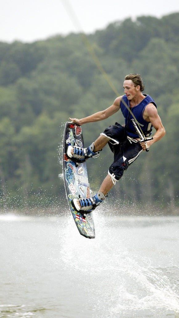 Brad Molnar in 2003 was practicing tricks at Taylorsville Lake. The Army Corps of Engineers in May lifted a toxic algae advisory for the popular lake south of Louisville.