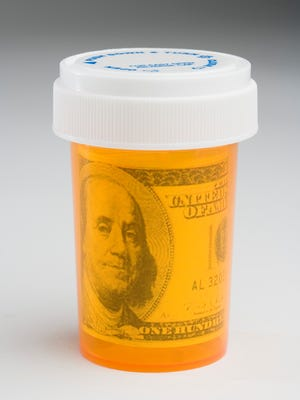 Hundred dollar bill in a pill bottle
