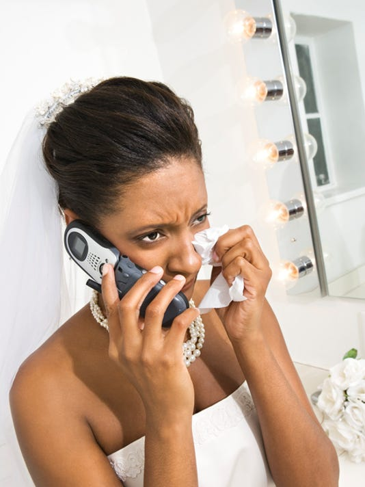 Upset bride using cell phone