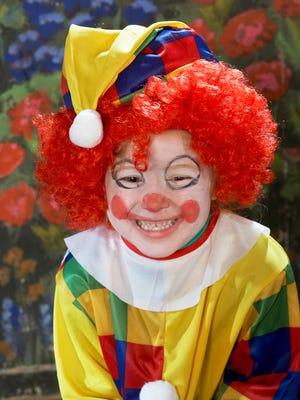 Girl wearing clown costume