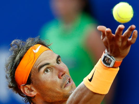 """FILE - In this Sunday, April 24, 2016 file photo, Spain's Rafael Nadal returns a ball to Japan's Kei Nishikori during the Barcelona Open tennis tournament final in Barcelona, Spain. Fed up with being accused of doping, Rafael Nadal has written to the president of the International Tennis Federation and asked for all of his drug-test results and blood profile records to be made public. """"It can't be free anymore in our tennis world to speak and to accuse without evidence,"""" the 14-time Grand Slam champion said in a letter obtained Tuesday, April 26, 2016 by The Associated Press. (AP Photo/Manu Fernandez, File)"""