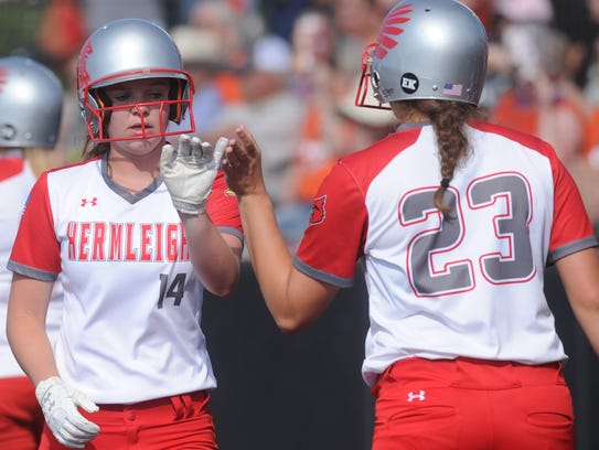 Hermleigh's Ciera Digby, left, gets a high-five from Makia Gonzales after scoring in a six-run fifth inning. Hermleigh won the one-game Region I-1A semifinal playoff game over Rotan 17-8 Saturday at ACU's Wells Field.