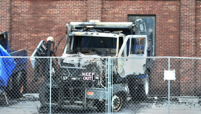 Fencing now surrounds the burnt out remains of the Irondequoit DPW building on Titus Avenue in Irondequoit Tuesday, Dec. 27, 2016.