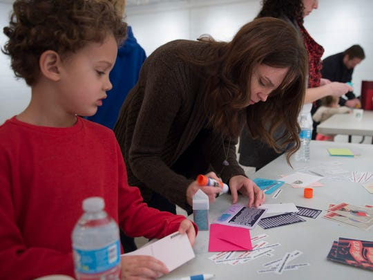 Sarah Coomer with her son Sky 5-years-old craft cards to send to Tennessee Senators Alexander and Corker during a card writing party Sunday Jan. 29, 2017, in Nashville, Tenn.