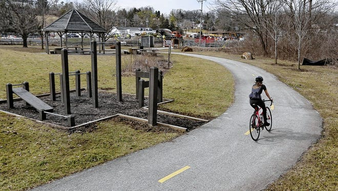 A cyclist makes a loop around the northern end of the Olentangy Trail at Worthington Hills Park last year. One goal of the five-year-old Olentangy Powell and Liberty Trails group is to connect the city and township trail systems to the Olentangy Trail.