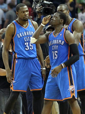 Thunder forwards Kevin Durant, left, and Serge Ibaka, right, were happy to see Reggie Jackson take center stage in Game 4 vs. the Grizzlies.