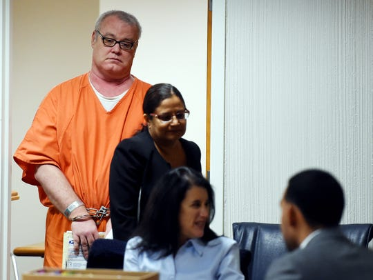 Brooks Bellay, 52, is lead into the courtroom Monday,