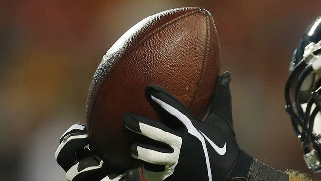 A receiver makes a catch of the football.