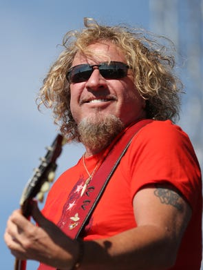Sammy Hagar performs with the Wabos during the Coors Light Carb Day concert at the Indianapolis Motor Speedway, Friday, May 23, 2014, in Indianapolis.