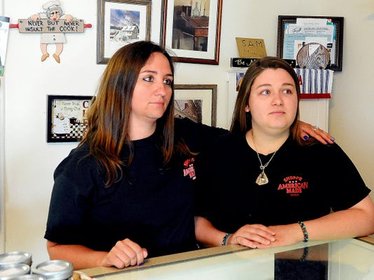 Alecia Armold (left) and Becky Schrum, the daughters of murder victim Barb Schrum, speak about their mother in the days after her death inside her store, Shoppe American Made.