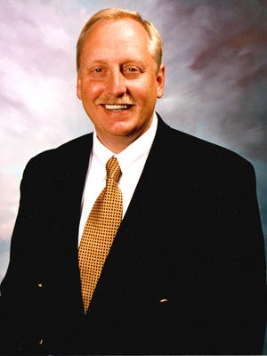 President Jimmy Johnson awarded a benefit auction specialist designation.