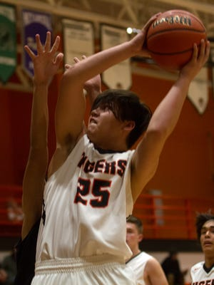 Aztec's Isaac Robeson attempts a shot against Crownpoint on Thursday at Lillywhite Gym in Aztec.