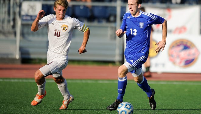Memorial's Andrew Cross (13) Chesterton's Tyler Schroeder (10) during the Class 2A state championship at Carroll Stadium in Indianapolis, Saturday, Oct. 29, 2016. Memorial beat Chesterton 2-1.