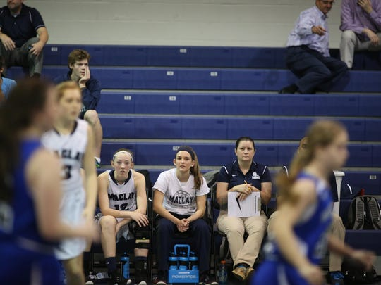 Maclay senior Ellie Stubblefield watches her team play in a District 1-3A semifinal on Tuesday at John Paul II. Stubblefield sat out with a concussion but leads the Marauders with 14.7 points per game.