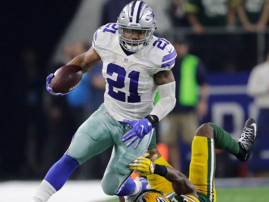 Dallas Cowboys' Ezekiel Elliott breaks away for a first down against Green Bay Packers' Kentrell Brice in the fourth quarter during their NFC Divisional playoff game Sunday, January 15, 2017, at AT&T Staduim in Arlington, Texas.