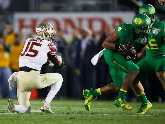 Oregon safety Erick Dargan makes an interception off the hands of Florida State wide receiver Travis Rudolph in the Rose Bowl college football playoff semifinal Thursday in Pasadena, Calif.