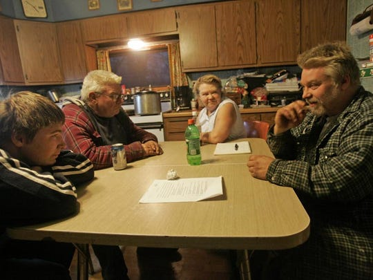 Steven Avery, right, with his parents, Allan and Delores Avery are shown in the Avery Cabin near Crivitz, Wis., on Nov. 5, 2005.  (AP Photo/The Milwaukee Journal Sentinel, Jeffrey Phelps)