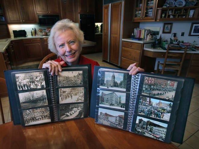 Barbara Hall shows part of her collection of 300 old scenic postcards related to Rochester from the turn of the century and early 1900s at her home in Victor.