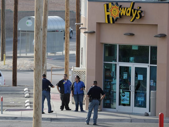El Paso Police Department officers stand at the scene