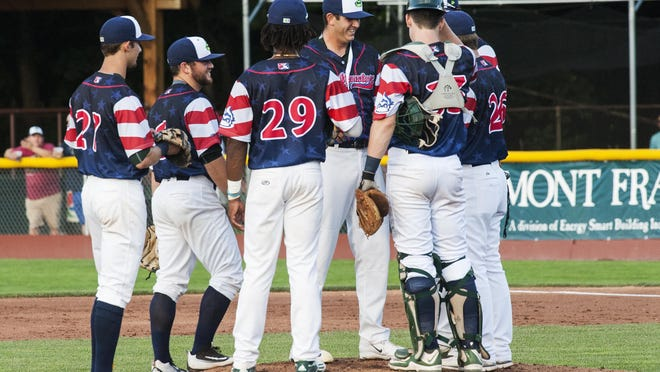 The Vermont infield huddles together as pitcher Brendan Butler enters the game during the baseball game between the Williamsport Crosscutters and the Vermont Lake Monsters at Centennial Field on Thursday night July 14, 2016 in Burlington.