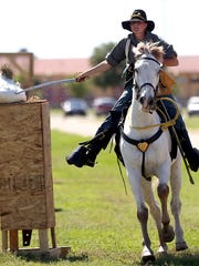 Courtney De Long practices for the saber competition during the Regional Cavalry Competition at Fort Concho National Historic Landmark in 2016