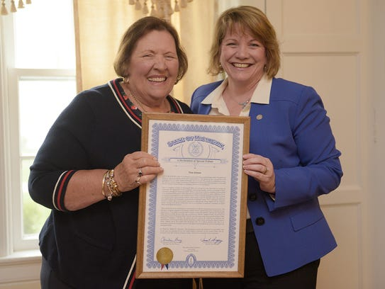 State Rep. Christine Greig presents a proclamation