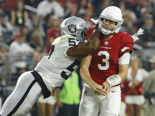 Raiders middle linebacker Cory James hits Cardinals