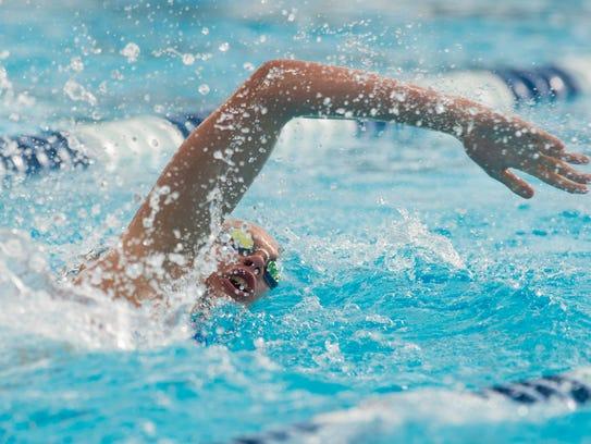 Jensen Beach's Emily Miller swims the 200 yard freestyle