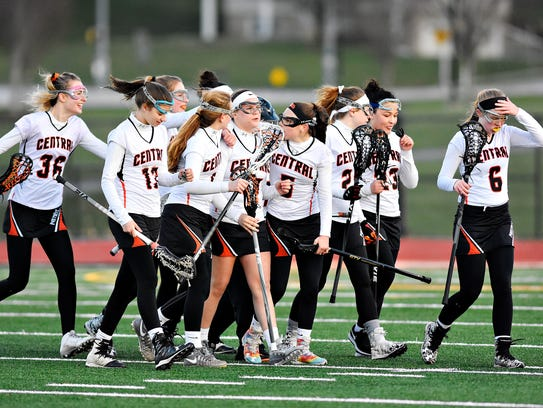 Central York celebrates a 19-5 win over Dover during girls' lacrosse action at Central York High School in Springettsbury Township, Wednesday, April 4, 2018. The Panthers are unbeaten in York-Adams League action. Dawn J. Sagert photo