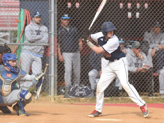 Ketcham's Bryce Mordecki, right, waits for a pitch