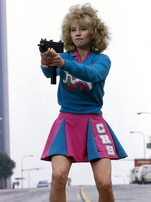 """Sam (Kelli Maroney) trades her pom-poms for an Uzi to deal with zombies in """"Night of the Comet."""""""