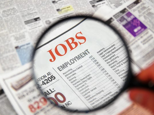 Job searching on newspaper using magnifier