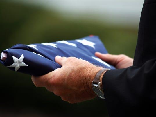 Holding folded flag