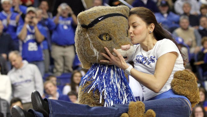 Actress Ashley Judd kisses the Kentucky mascot as she is carried during a time out in the second half of Kentucky's 76-68 win over Georgia in an NCAA college basketball game at Rupp Arena in Lexington, Ky., on Saturday, Jan. 9, 2010.