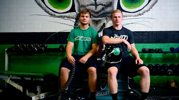 Mountain Heritage's Trey Robinson, right, and Adam