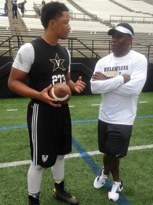 Van Heflin Jr., left, talks with Vanderbilt coach Derek Mason at the Commodores' football camp. Heflin hopes to follow in his father's football footsteps and play at Vanderbilt.