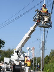 AT&T worker on a utility pole
