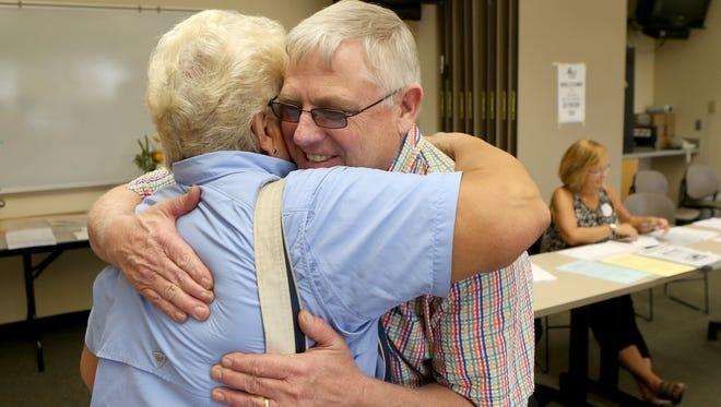 Jack Moore hugs Joanne Day before voting in Henrietta on Sept. 10, 2015.