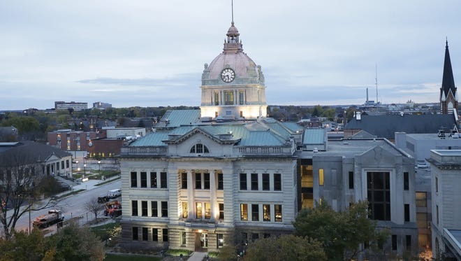 The Brown County Courthouse, with its refurbished rotunda roof glows under accent lights. Contractors in 2017 completed a $1.7 renovation of the dome, completing a restoration of the courthouse that began with interior work in the 1990s.