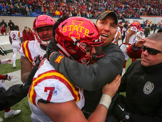 Iowa State Cyclones linebacker Joel Lanning (7)  hugs coach Matt Campbell after their victory in the AutoZone Liberty Bowl Saturday, Dec. 30, 2017, in Memphis, Tennessee. ISU defeated Memphis 21-20.