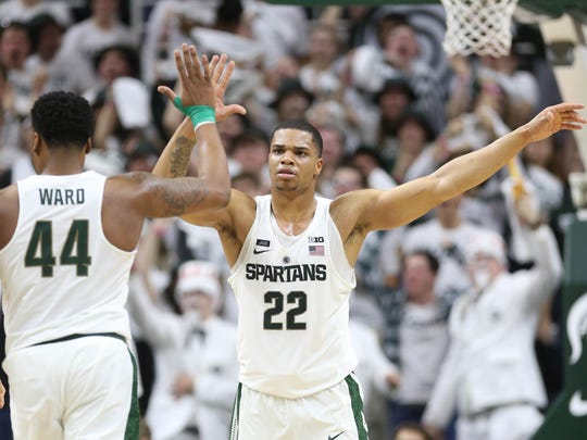 Michigan State forward Nick Ward and guard Miles Bridges high five after a basket during second half action against Penn State Wednesday, January 31, 2018 at the Breslin Center in East Lansing.