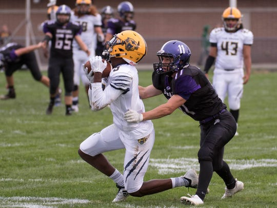 Battle Creek Central's Keondre Glass (5) gets an interception
