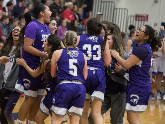 Spanish Springs players celebrate after beating Reno