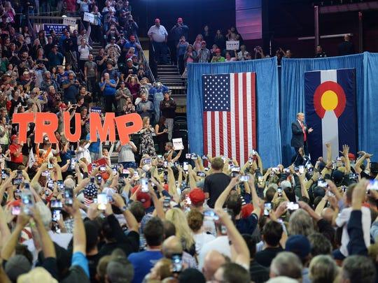Donald Trump enters a rally at the Budweiser Event Center in Loveland on October 3, 2016.
