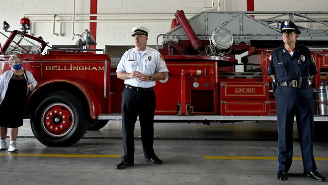 Franklin Fire Chief James McLaughlin, center, introduces the public to a retired Franklin Fire Department  American-LaFrance aerial ladder truck from 1949 during a ceremony at fire department headquarters onJune 30.  The apparatus  was in service in Franklin from 1949-1985 and in Bellingham from 1985-1996.  At left is Denise Molloy, the widow of former Franklin Fire Chief Francis Molloy, and at right is Bellingham Police Sgt. Ed Guzowski, who previously owned and restored the antique. He wanted to return the truck back to its home town before retiring to Florida this year. [Wicked Local Staff Photo/Ken McGagh[