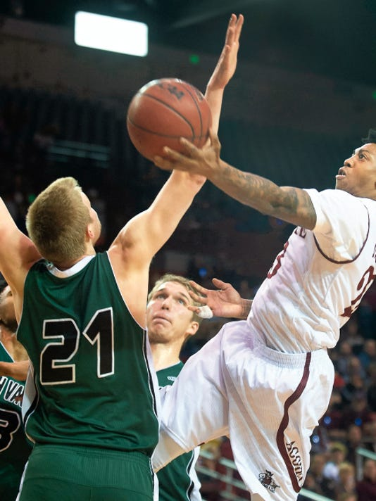 Sun-News file photo by Gary Mook   Former New Mexico State star Daniel Mullings has signed a one-year deal to play in the top professional league in Germany.