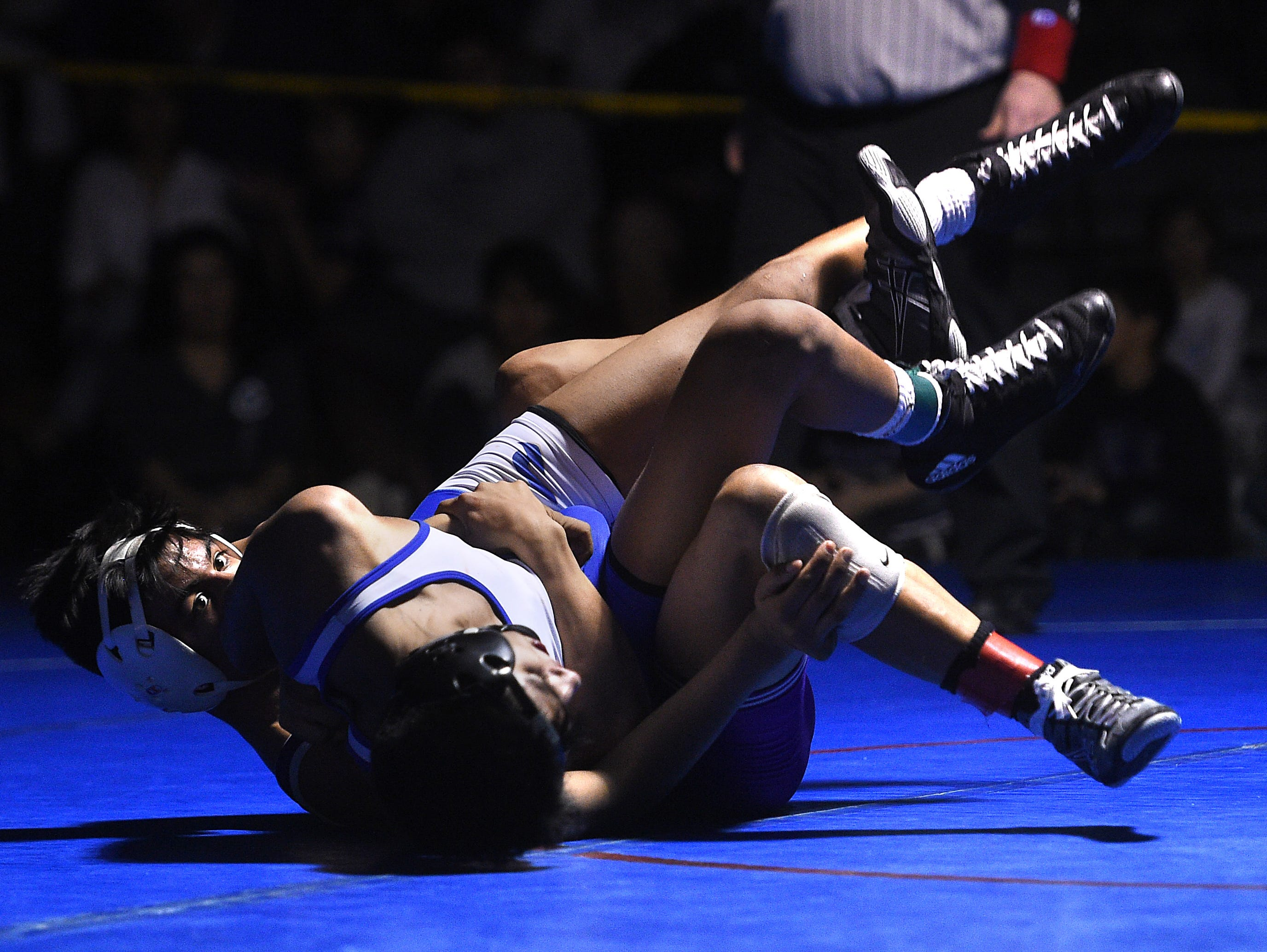 Spanish Springs' Jacob Ruiz, left, defeats Reed's Alex Casarez to win the 120-pound division during the 4A Northern Region Wrestling championships at Reno High School on Saturday.