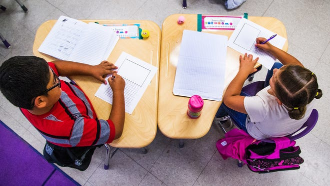 Kindergarten students do their work in class at Gila Bend Elementary School on April 20, 2017.